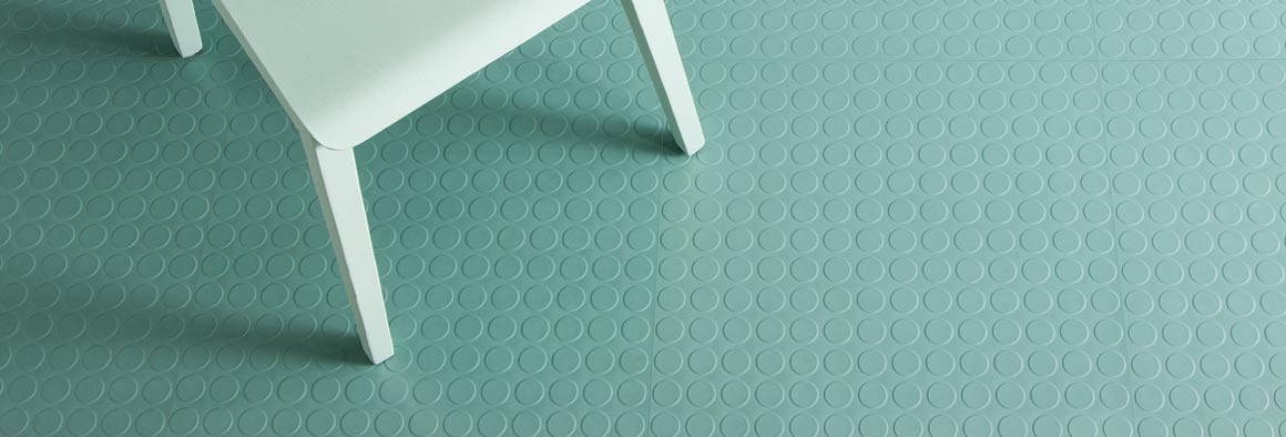 Green flooring with studs