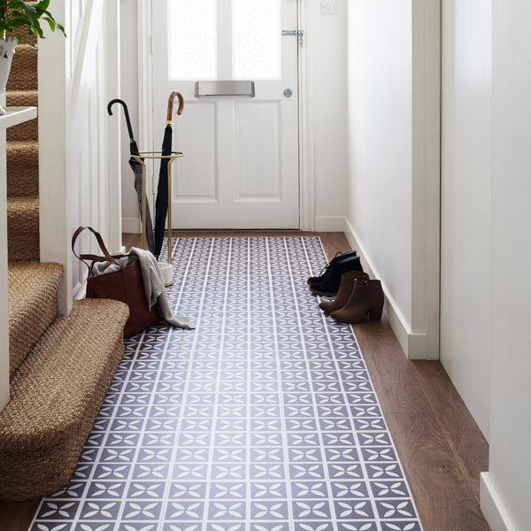 vinyl oak planks with purple tiles in a hallway