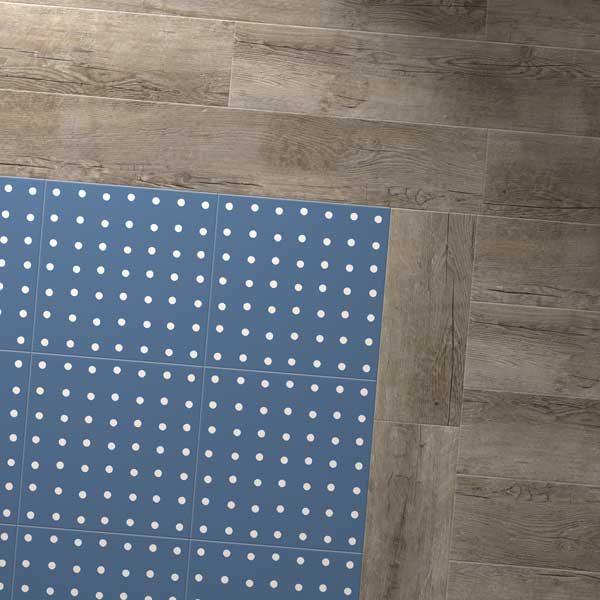 Blue vinyl spot floor with grey wood