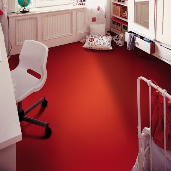Red flooring tile in a bedroom