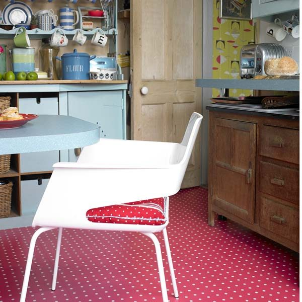 Red polka dot flooring in a kitchen