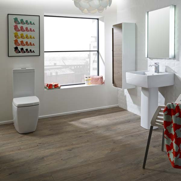 Bathroom with tan wood effect flooring