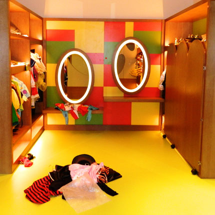 Yellow flooring in a kids changing room