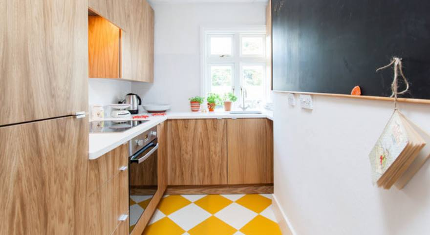 yellow and white check flooring in a kitchen