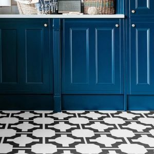 monochrome utility room flooring with blue kitchen units