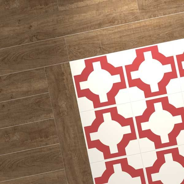 wood flooring bordering patterned red tile