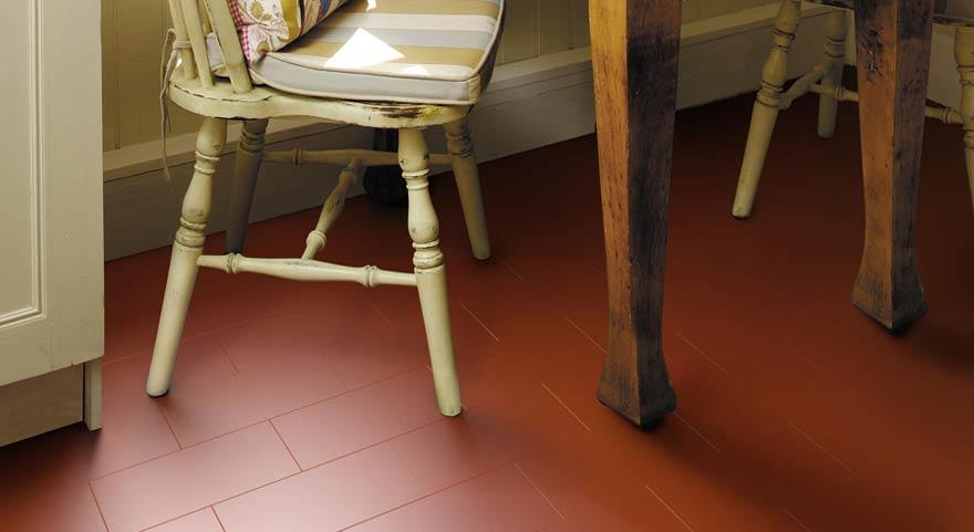 red vinyl flooring tiles in a herringbone pattern