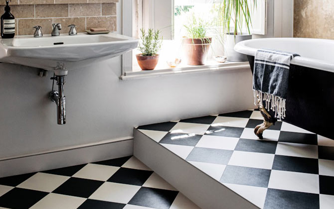 black and white chequerboard floor in a bathroom
