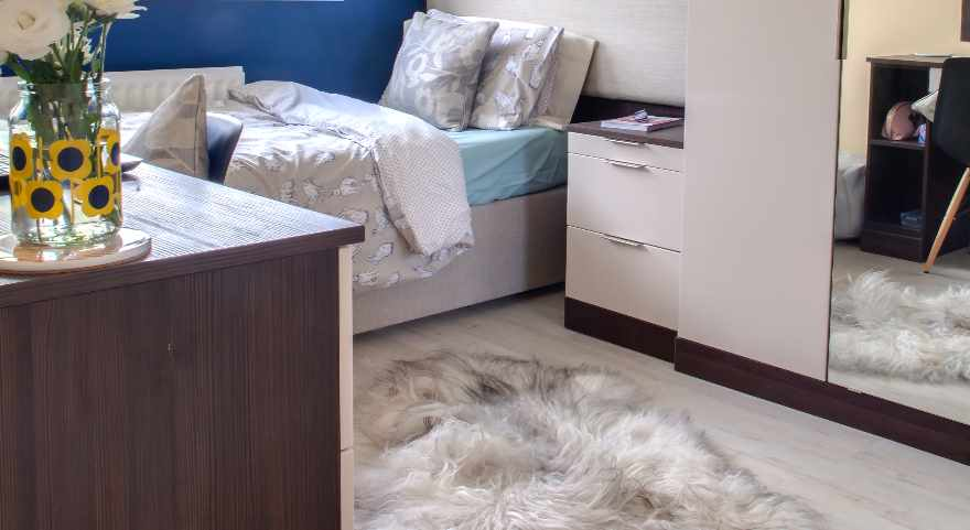 Wood effect vinyl flooring planks in bedroom