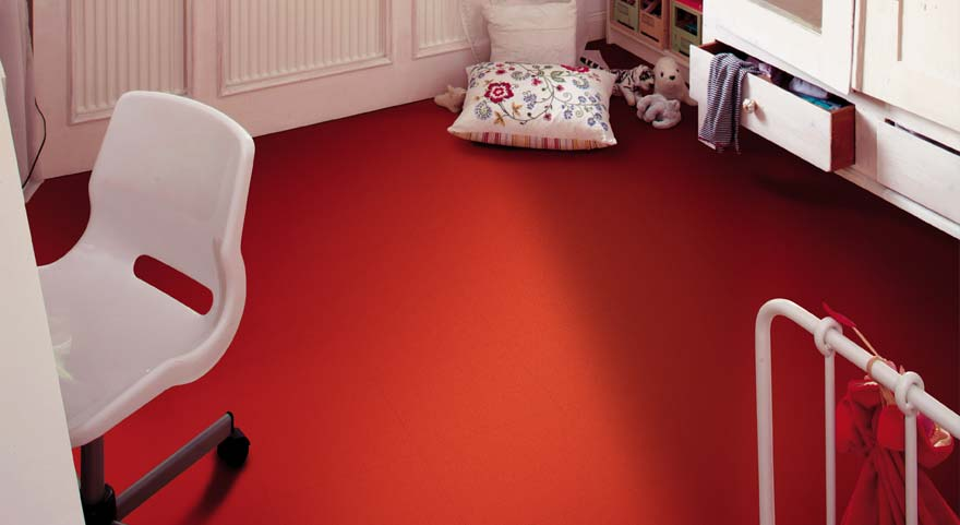 Red vinyl floor tiles in a bedroom