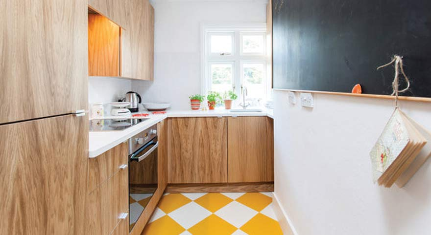 yellow and white tiles in wooden kitchen