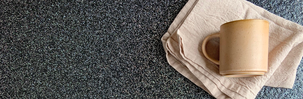 black sparkly flooring with pink textiles