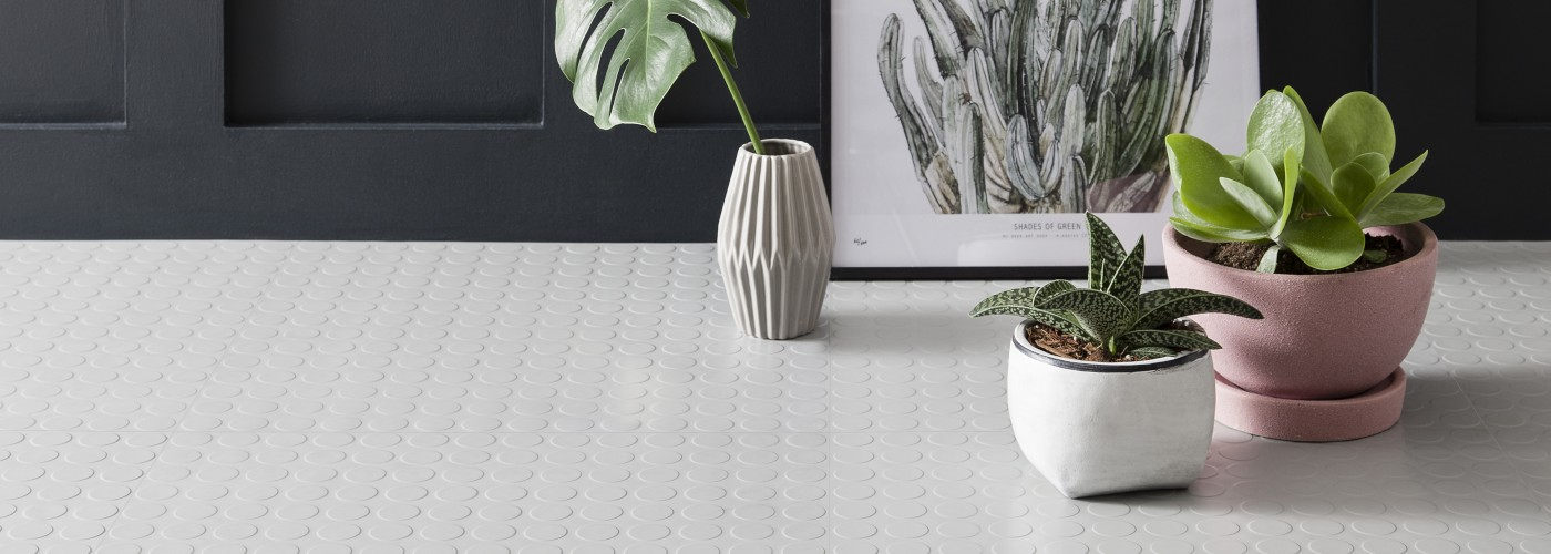 light grey rubber studded floro tiles with modern plants