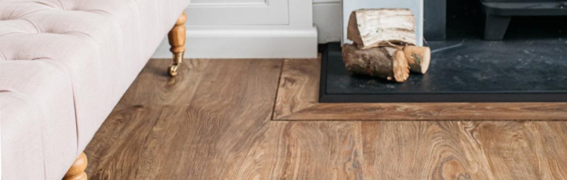 brown wood effect floor in living room with a log burner