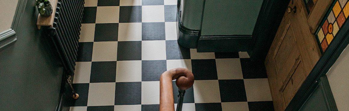 chequerboard monochrome floor tiles in traditional hallway