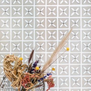 patterned floor tiles lattice with dried flower basket