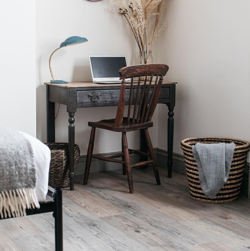 rustic wood effect flooring in modern bedroom