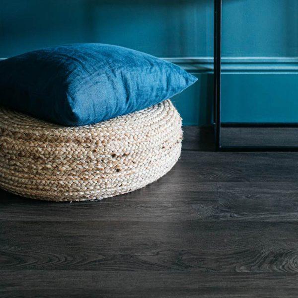 smoked oak wood plank floor in blue room