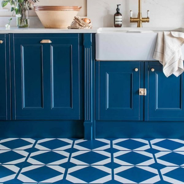 deep blue kitchen units with mathcing lvt geometric floor tiles