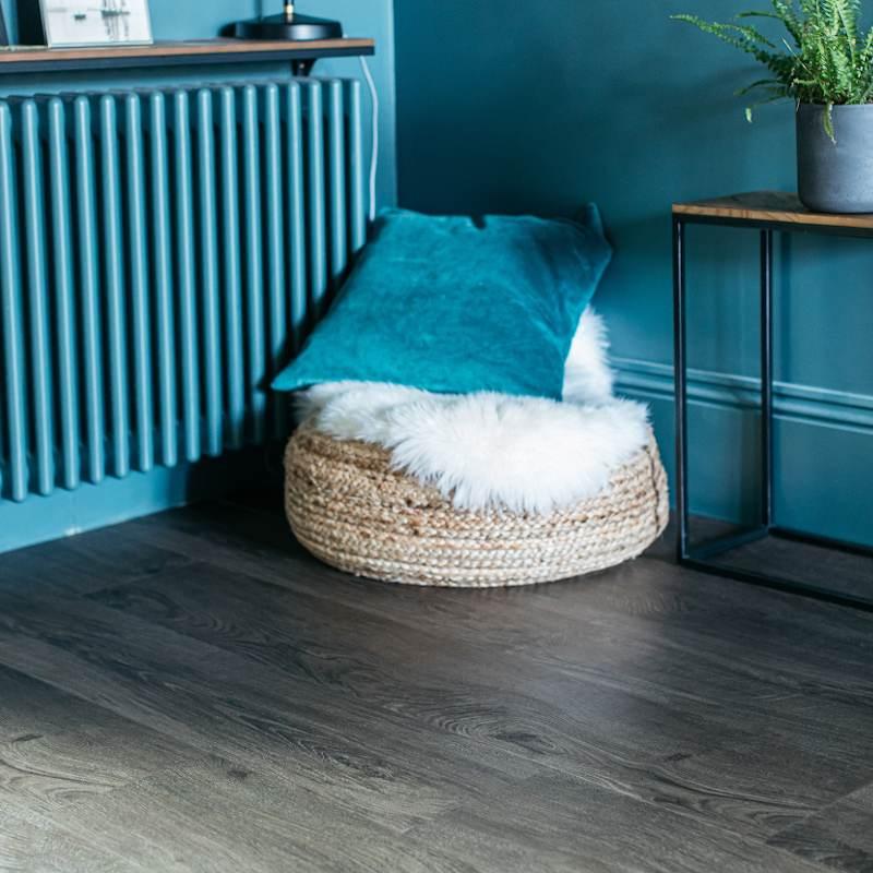 blue interiors with dark wood plank flooring