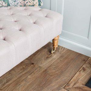 light wood floor planks with pink sofa