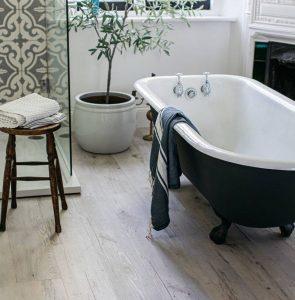 bathroom floor wood effect with roll top bath