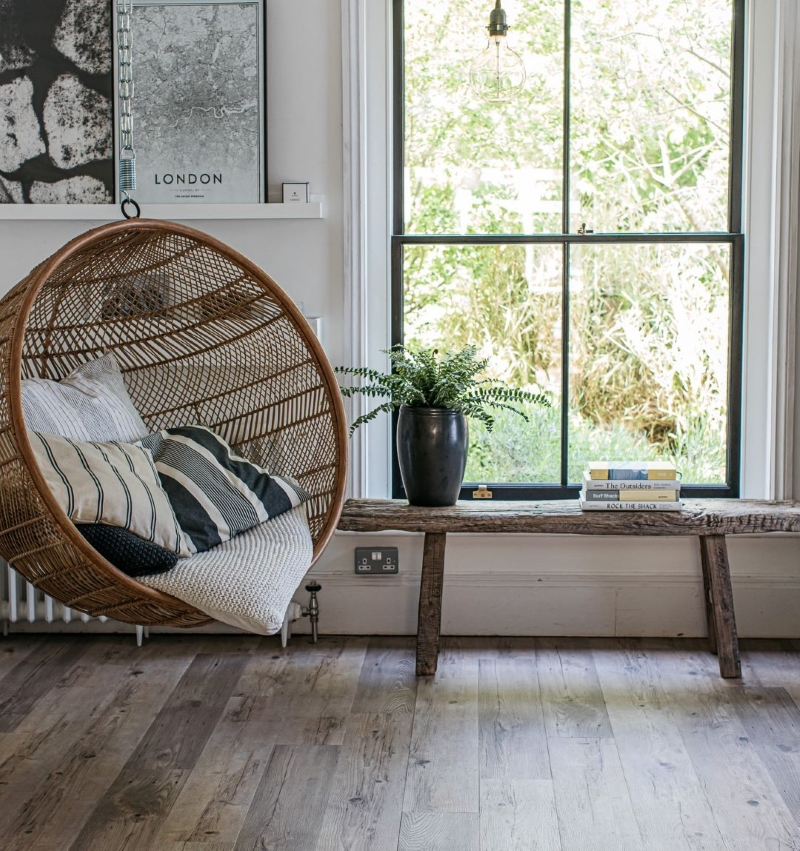 Tawn wood effect flooring with hanging chair
