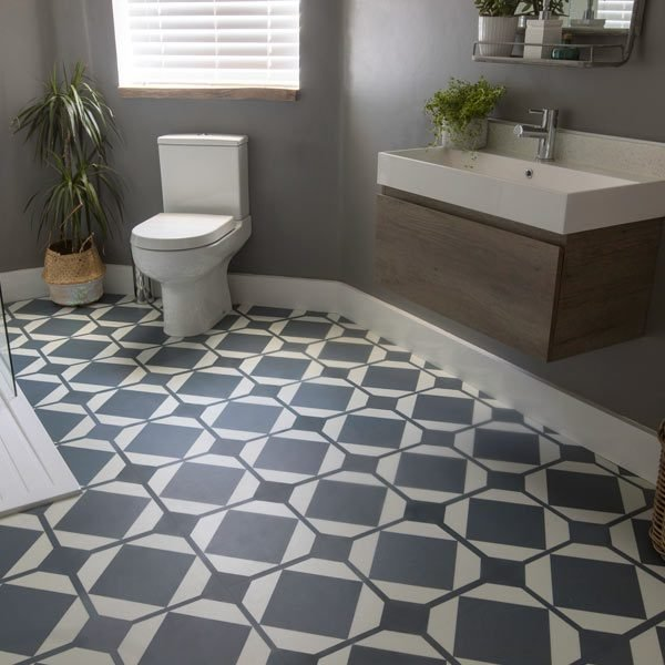 Grey blue floor tiles in modern bathroom