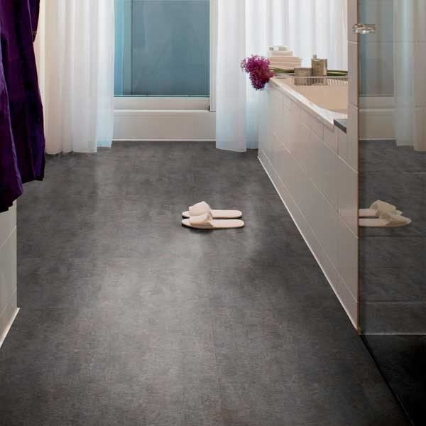Blue concrete effect vinyl floor in a bathroom