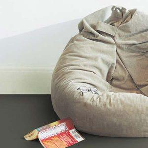 Light brown flooring and a beanbag