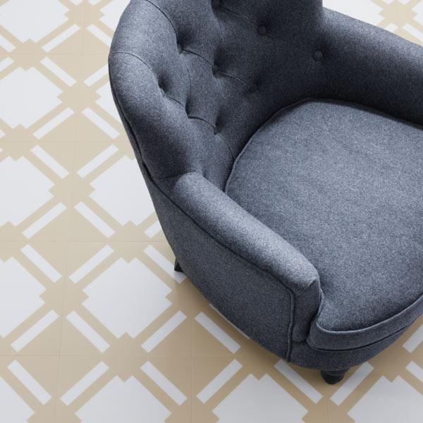 Ochre floor tile with grey armchair