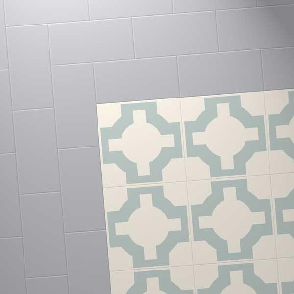 light blue paruqet tiles with a grey border