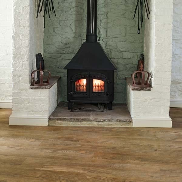 Oak effect vinyl flooring by a fireplace