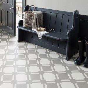 dark wood becnh with light grey floor tiles