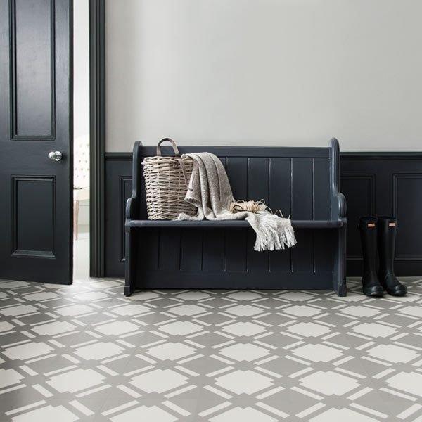 Flint grey floor tiles in booat room with a bench