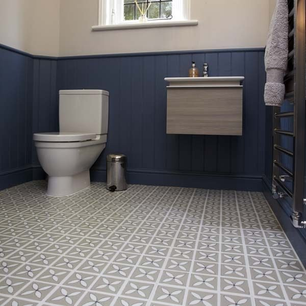 Grey floral pattern tile in a bathroom