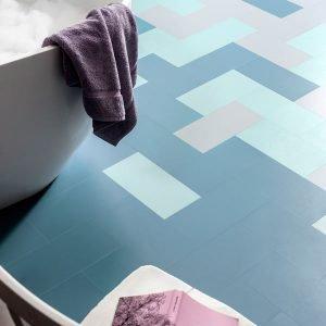 Blue floor tiles in a bathroom
