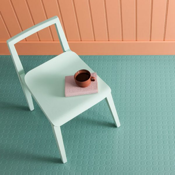 mint green rubber flooring with a white chair from above