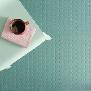 mint green rubber flooring with a coffee