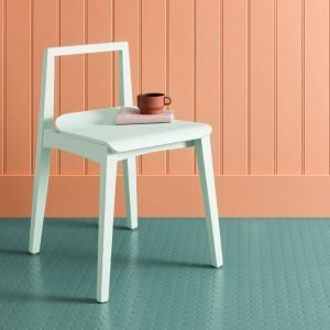 mint green rubber flooring with a white chair