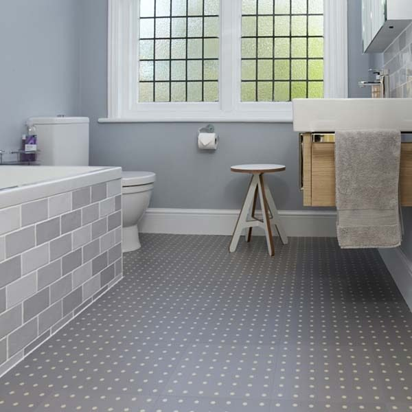 Grey polka dot flooring in a bathroom