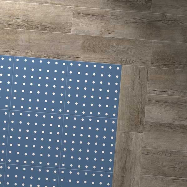 Blue vinyl spot floor with grey wood