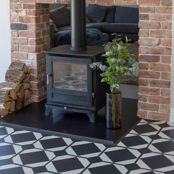 black and white floor tiles around black log burner