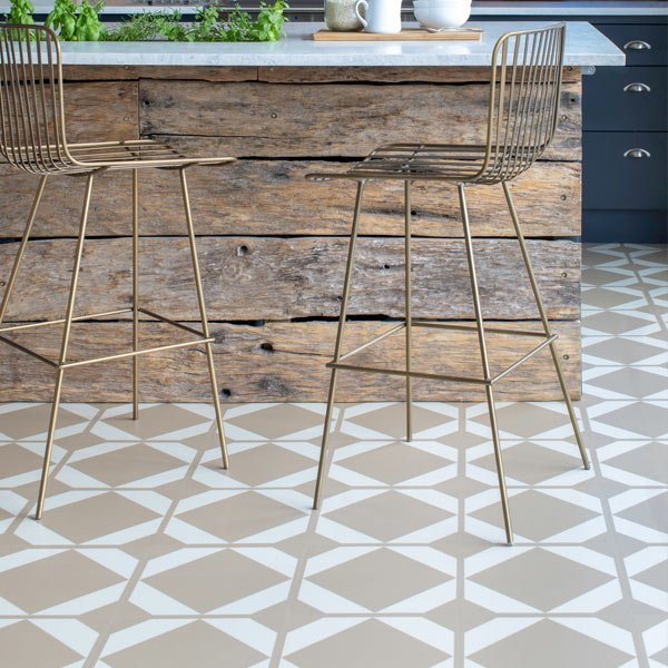 Brass bar stools surrounded by yellow floor tiles