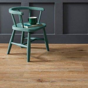 Wooden vinyl floor with green chair