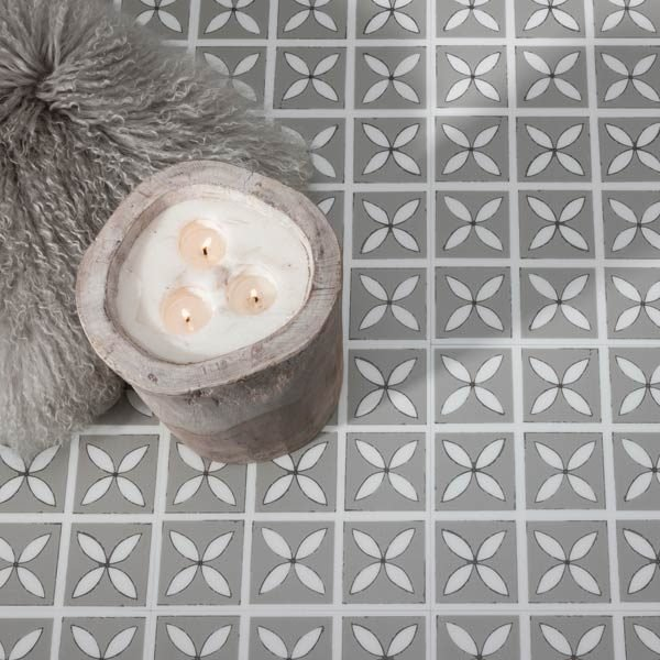 Grey floral floor tiles with candles