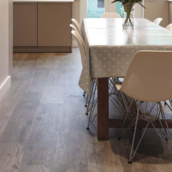 Aged oak effect flooring in a dining room