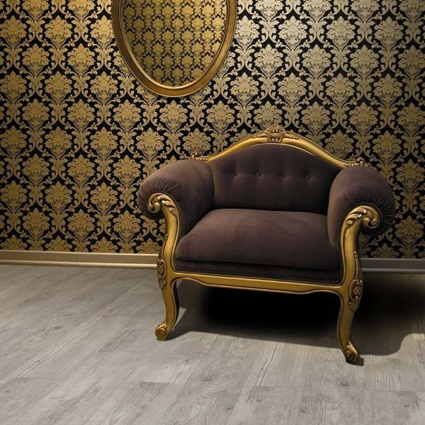 Aged oak look flooring and an armchair