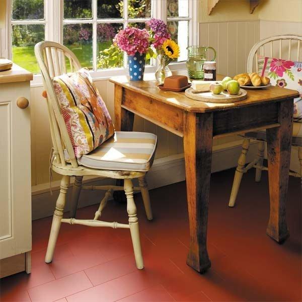 Red vinyl floor tile in a kitchen