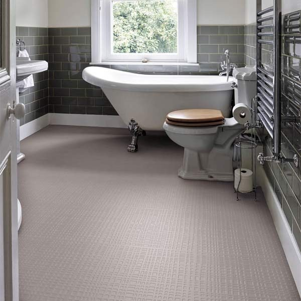 Beige rubber grid floor in a bathroom